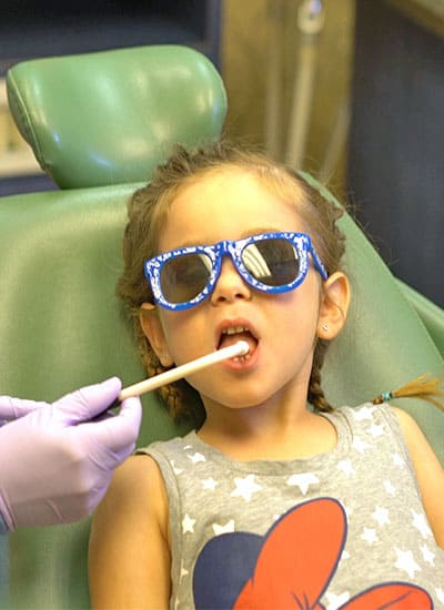 A child having their mouth examined at the dentist